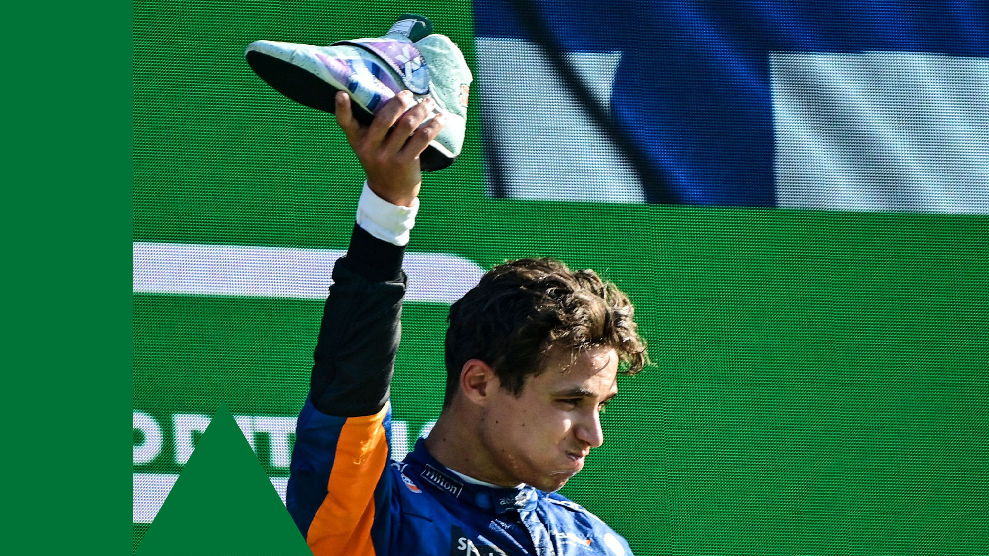 Second-placed McLaren's British driver Lando Norris drinks out of a shoe as he celebrates on the podium after the Italian Formula One Grand Prix at the Autodromo Nazionale circuit in Monza, on September 12, 2021. (Photo by ANDREJ ISAKOVIC / AFP) (Photo by ANDREJ ISAKOVIC/AFP via Getty Images)