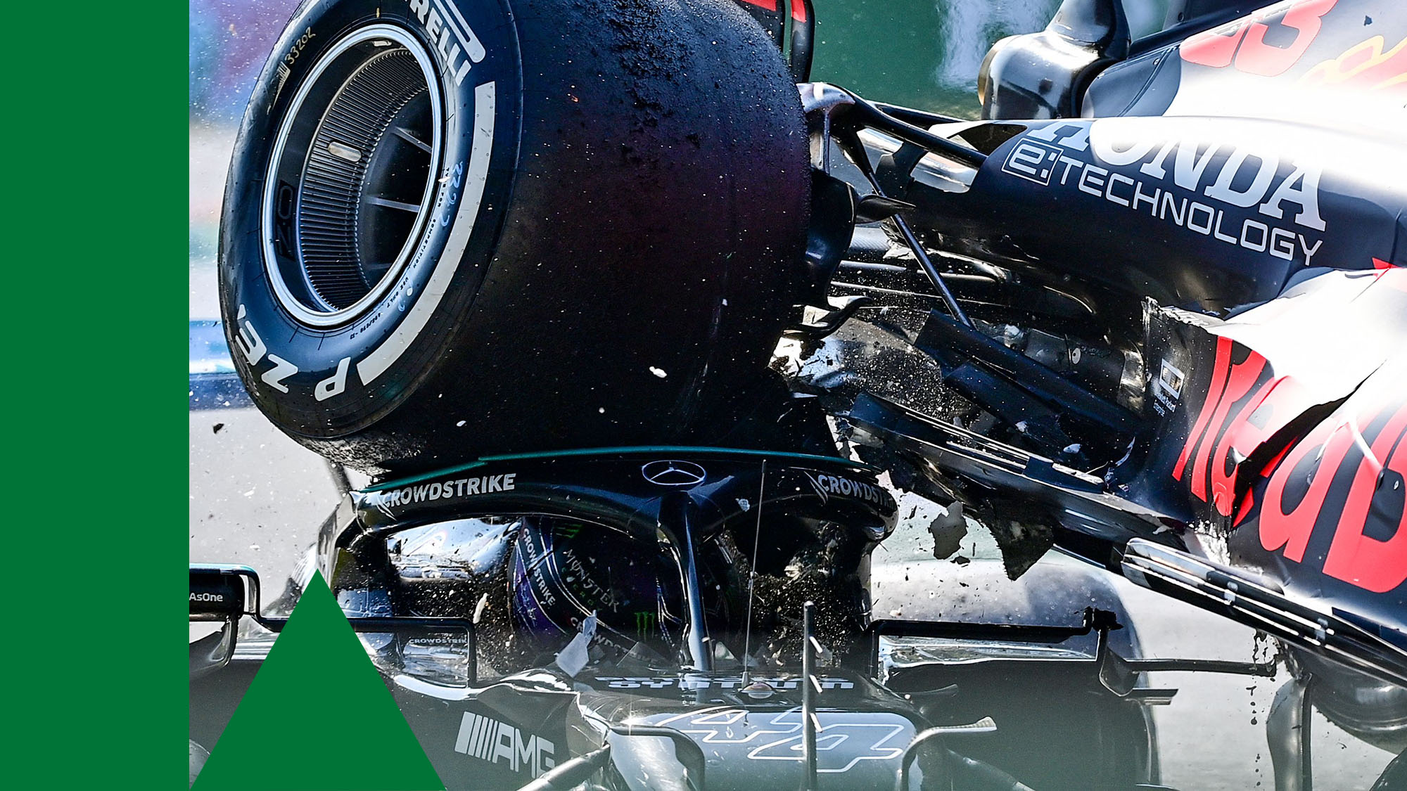 TOPSHOT - Mercedes' British driver Lewis Hamilton (L) and Red Bull's Dutch driver Max Verstappen collide during the Italian Formula One Grand Prix at the Autodromo Nazionale circuit in Monza, on September 12, 2021. (Photo by ANDREJ ISAKOVIC / AFP) (Photo by ANDREJ ISAKOVIC/AFP via Getty Images)