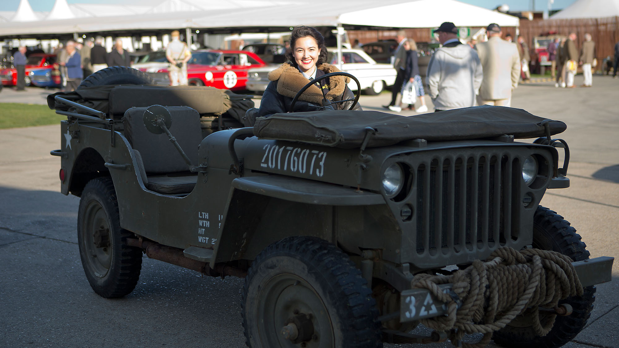 CHICHESTER, ENGLAND - SEPT 7th: Stylish young lady in fur lined flying jacket driving military vehicle/jeep during the 20th anniversary of the Goodwood Revival at Goodwood on September 7th 2018 in Chichester, England. (Photo by Michael Cole/Getty Images)