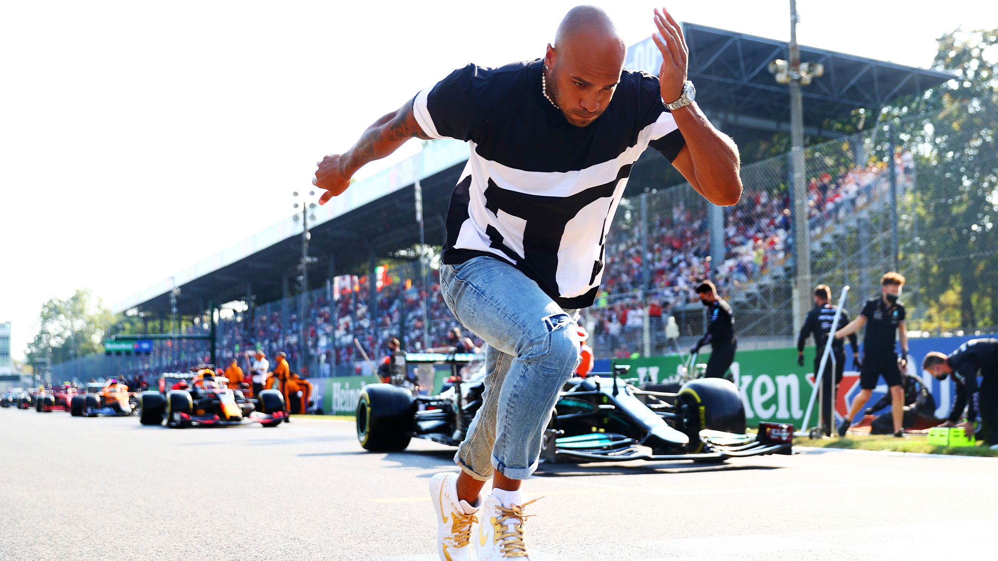 Lamont Marcell Jacobs runs om the F1 grid ahead of Monza sprint qualifying