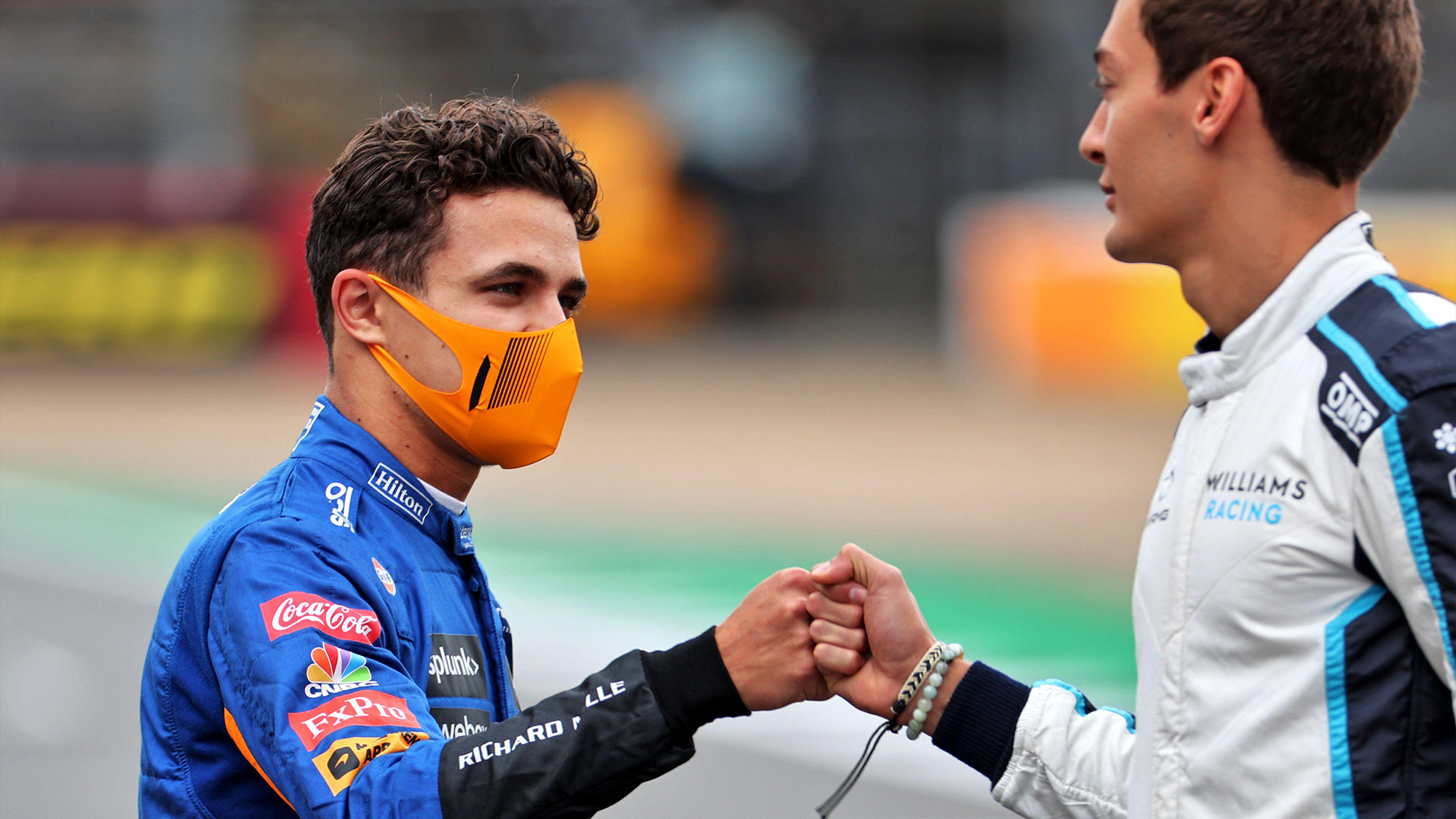 Lando Norris and George Russell bump fists at Silverstone 2021