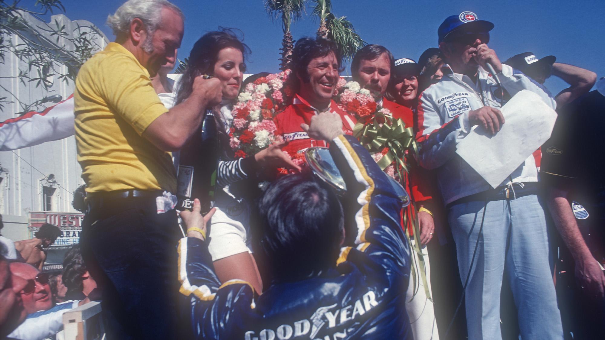 Mario Andretti on the podium at the 1977 Long Beach Grand Prix