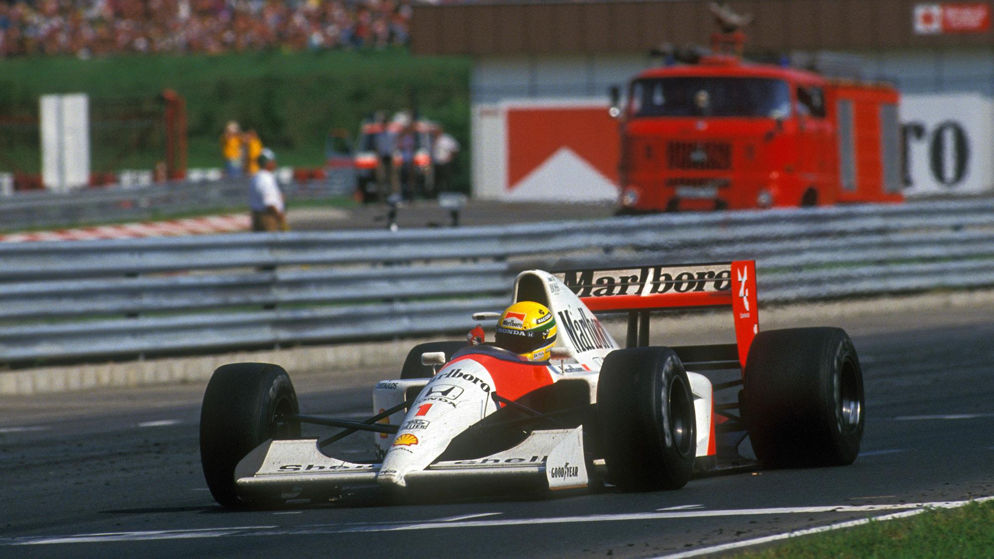 Ayrton Senna crosses the line to win the 1991 Hungarian Grand Prix