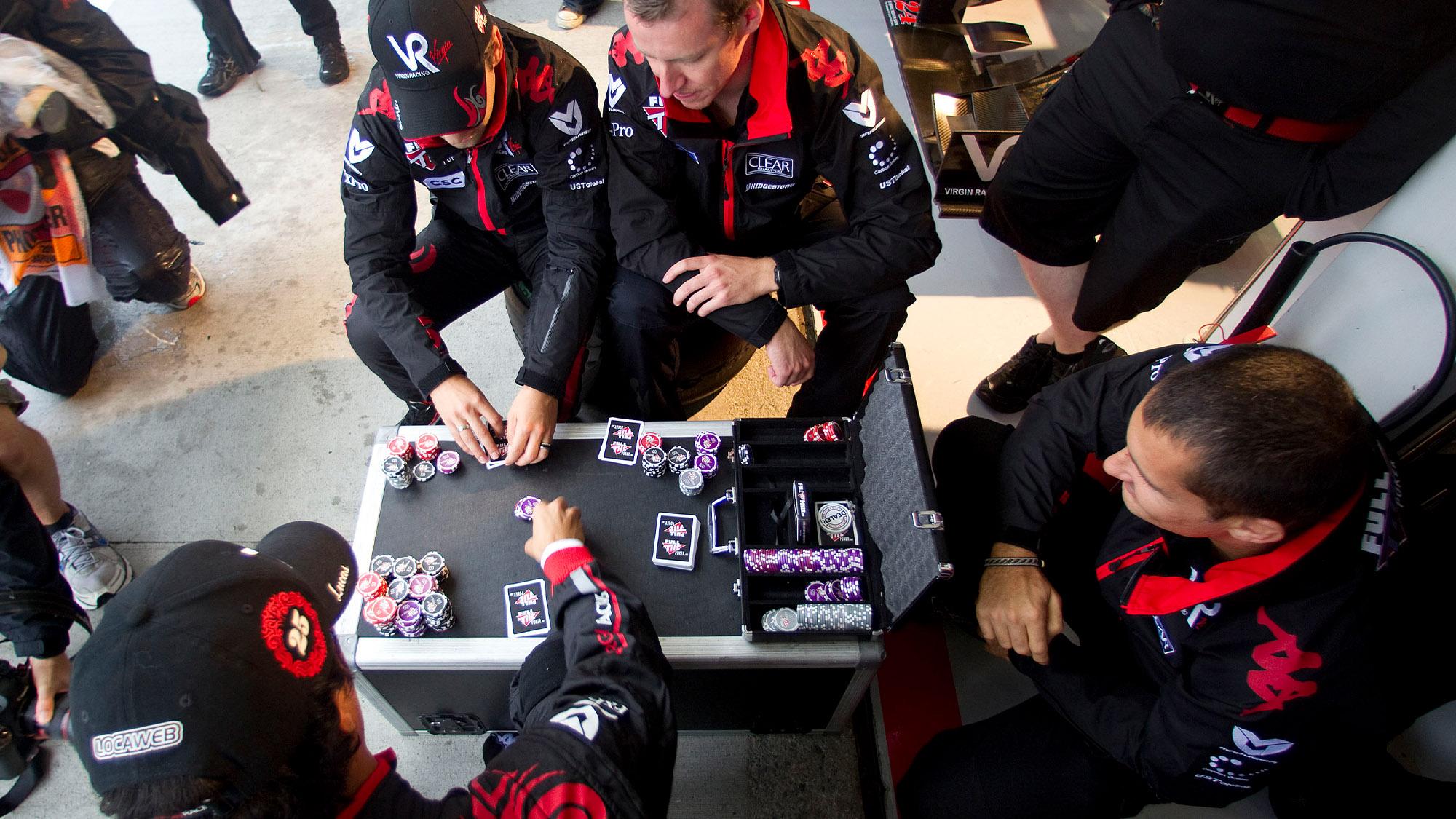 Virgin racing drivers play poker at the 2010 Japanese Grand Prix
