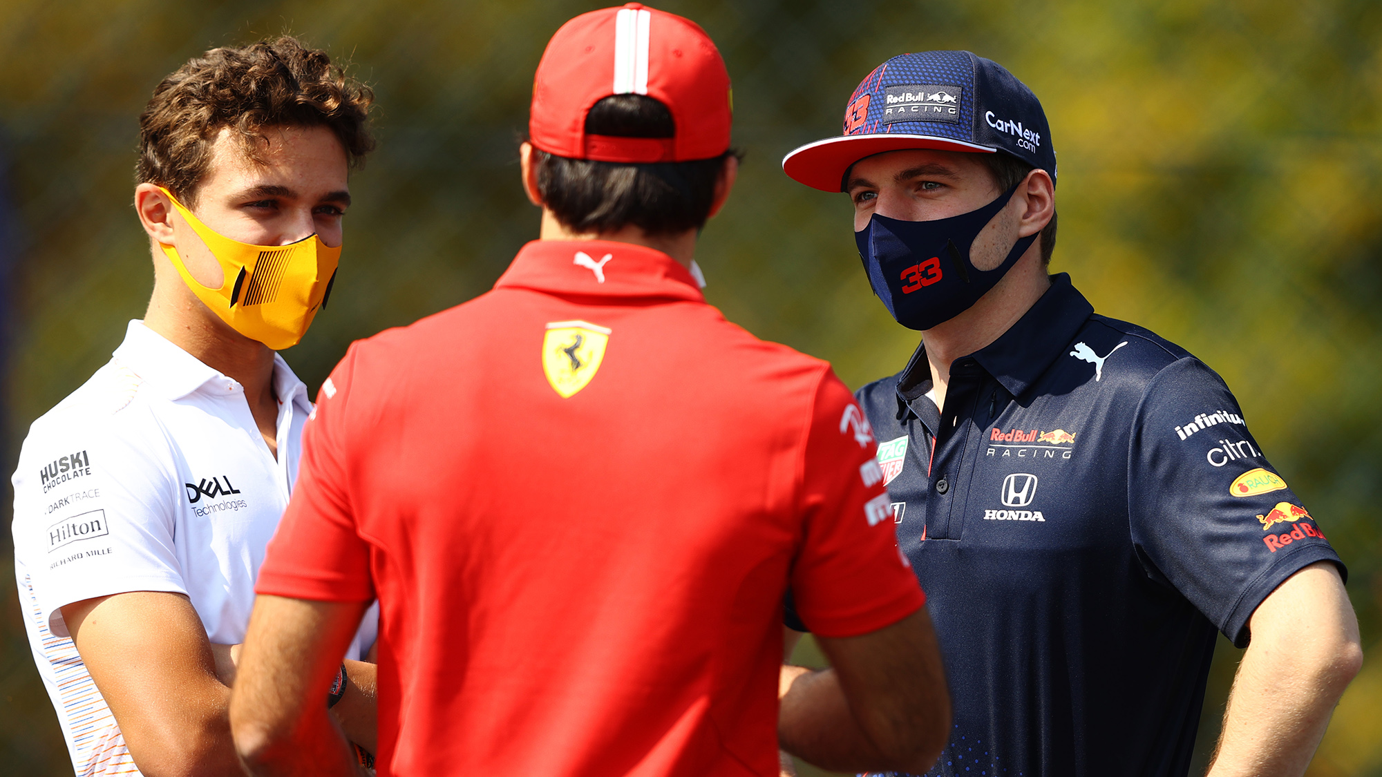 Max Verstappen talks with Lando Norris and Charles Leclerc at monza 2021