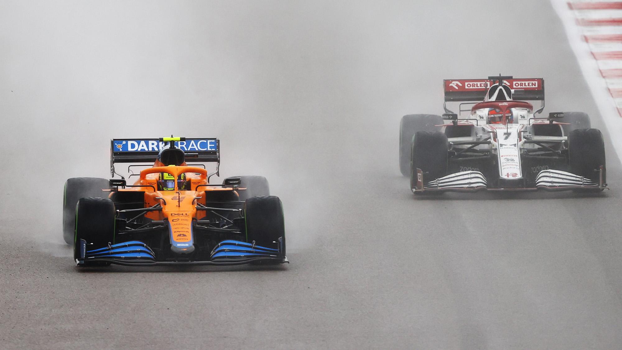 Lando Norris goes past Kimi Raikkonen in the rain at the 2021 Russian Grand Prix