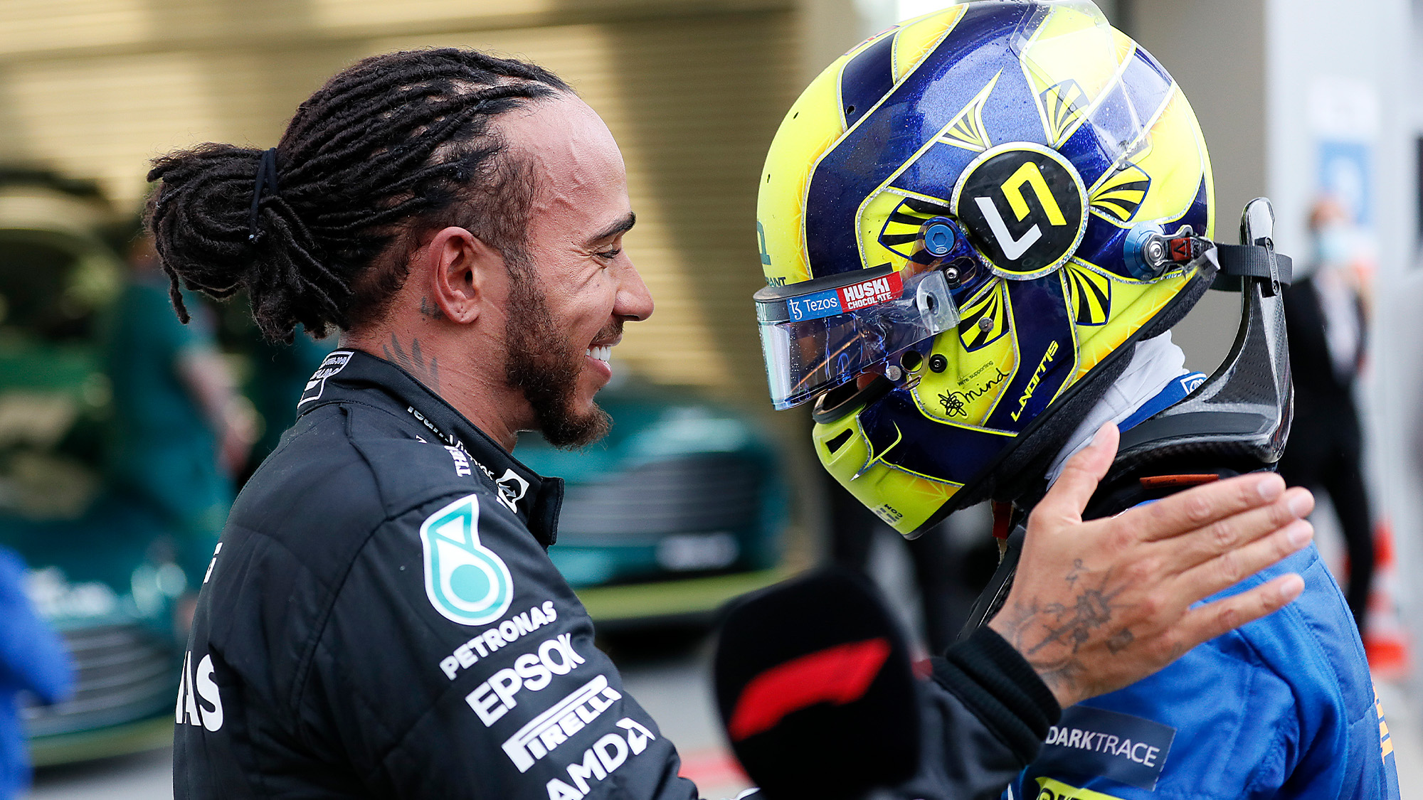 Lewis Hamilton talks to Lando Norris after winning the 2021 Russian Grand Prix