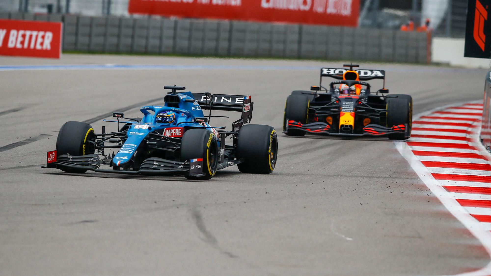 Fernando Alonso passes Max Verstappen in the 2021 Russian Grand Prix