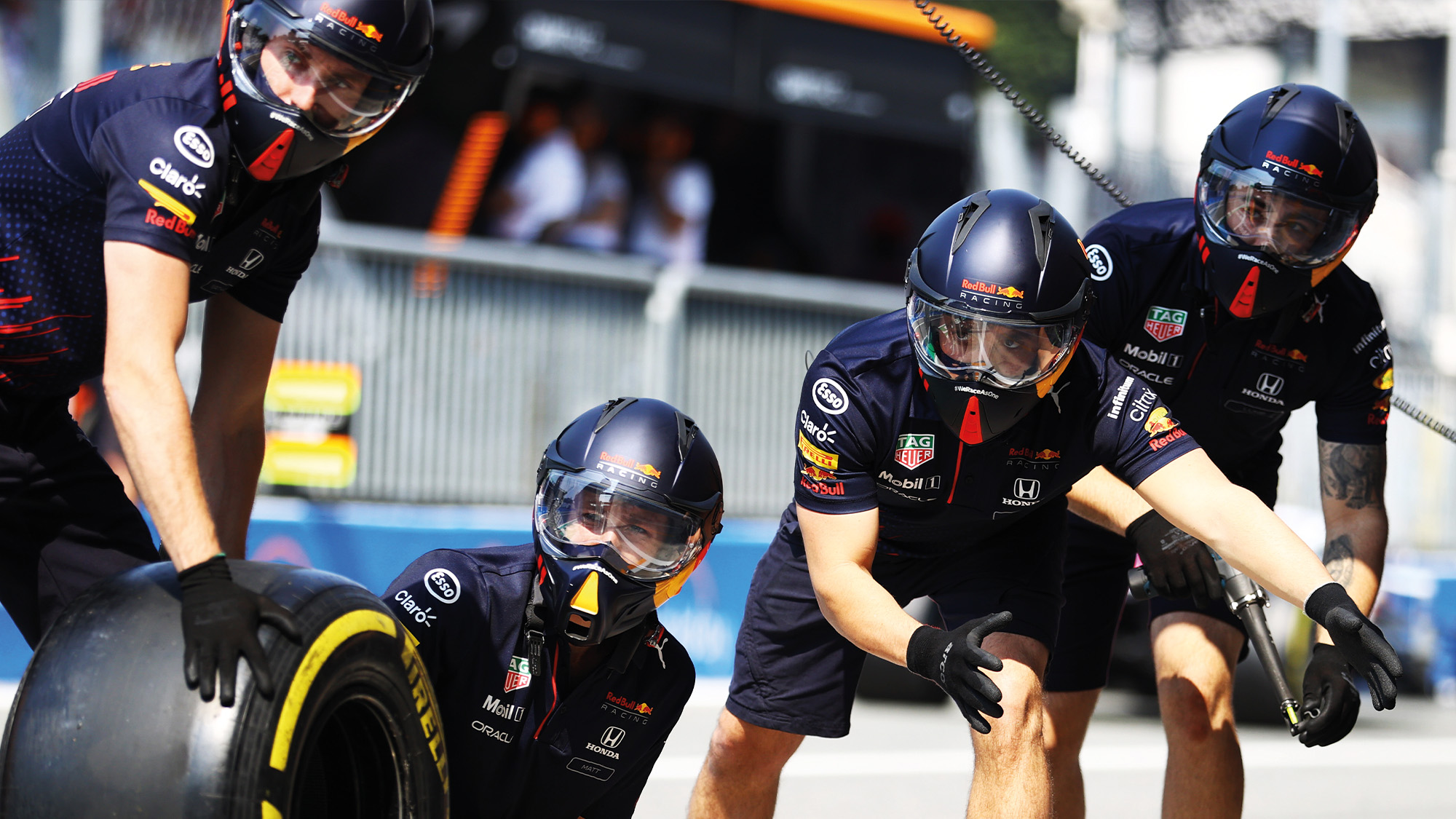 Red Bull mechanics wait for a pitstop