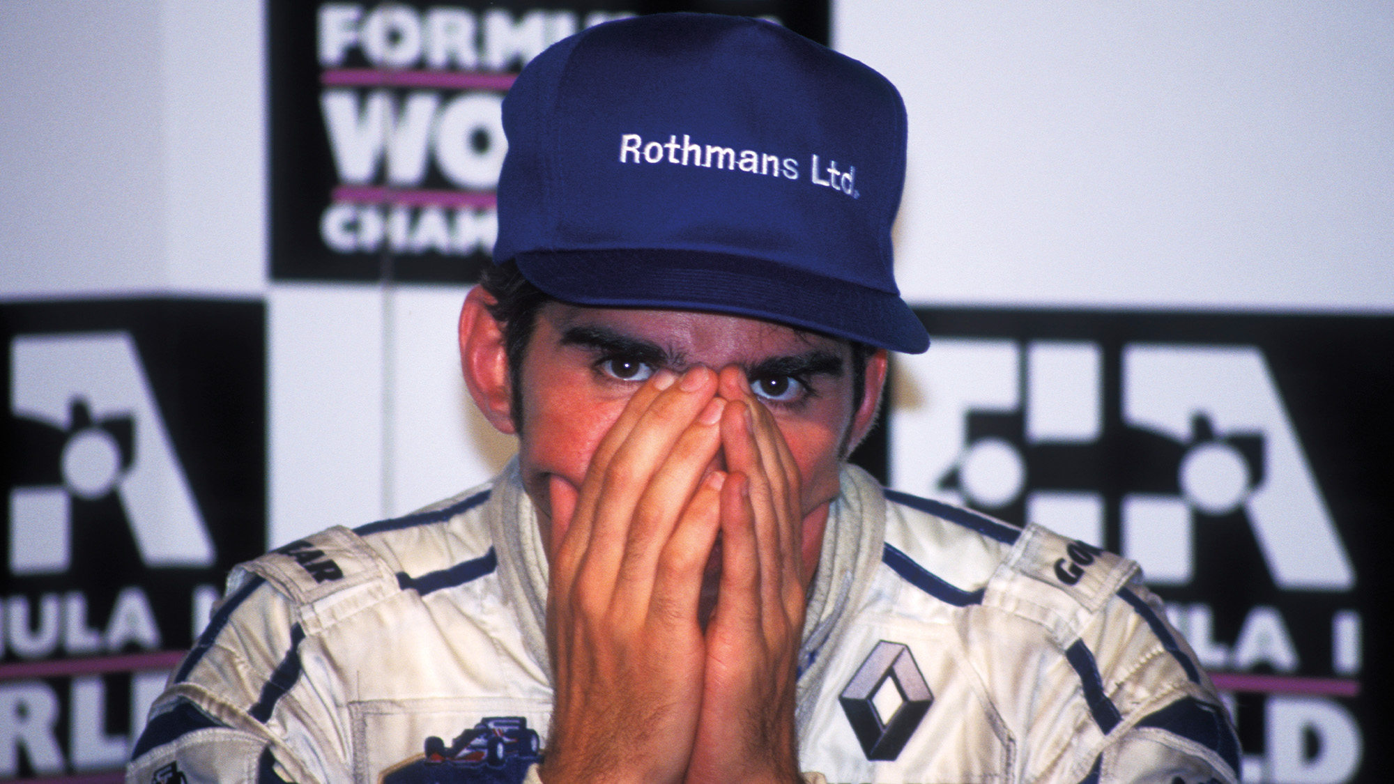 Damon Hill with head in his hands in 1996