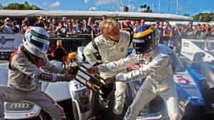 Allan McNish and David Brabham put ona. fight for the 2009 Le Mans winners trophy