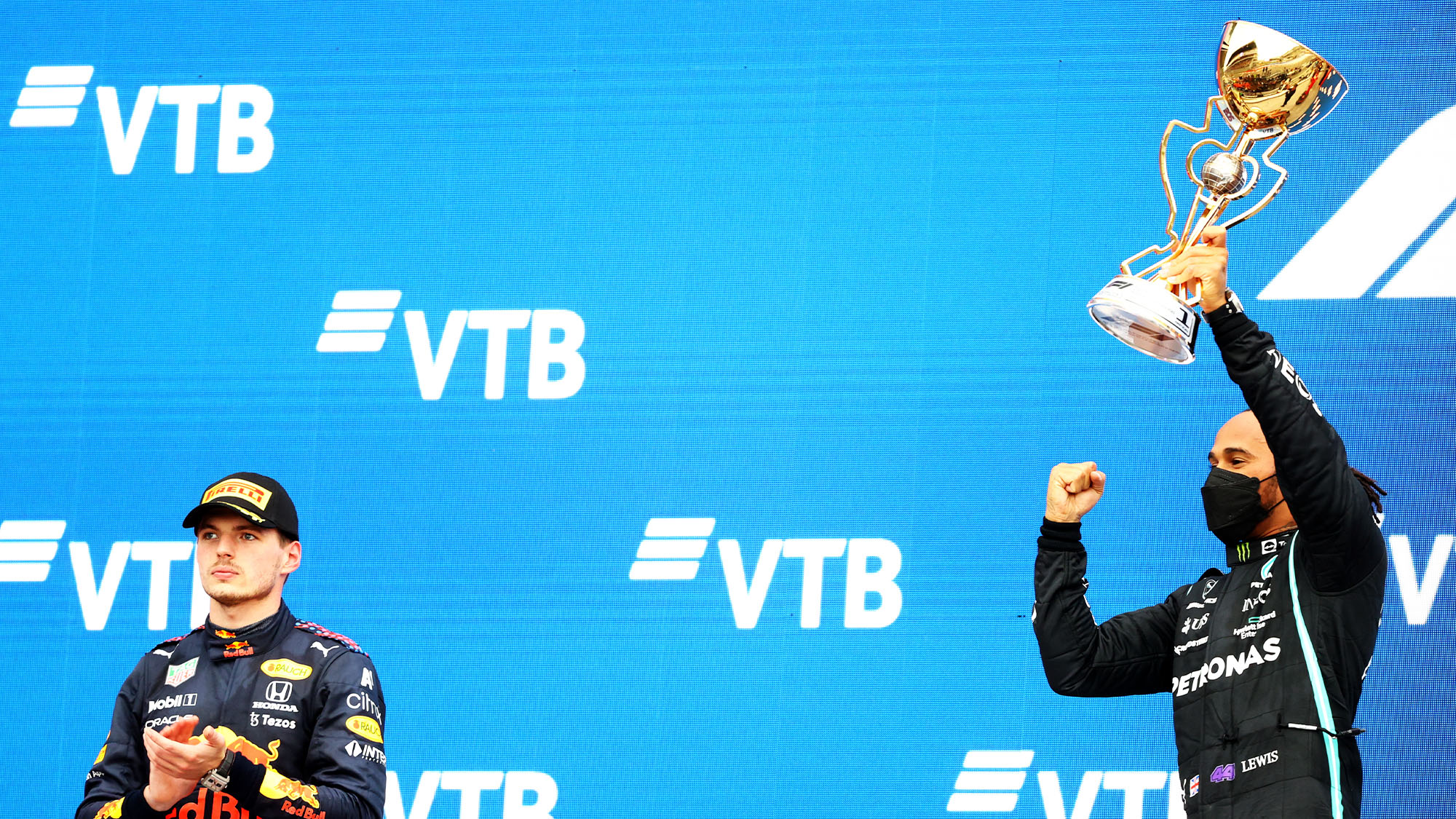 Lewis Hamilton and Max Verstappen on the podium at Sochi 2021