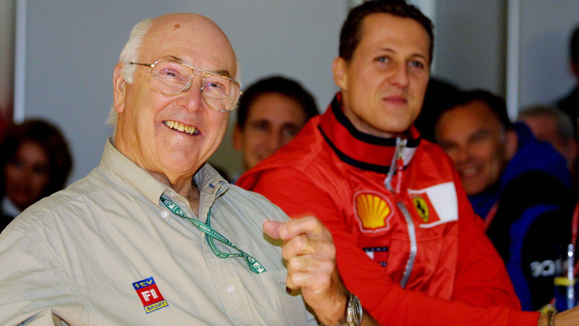 Michael Schumacher with Murray Walker at the 2001 US Grand Prix