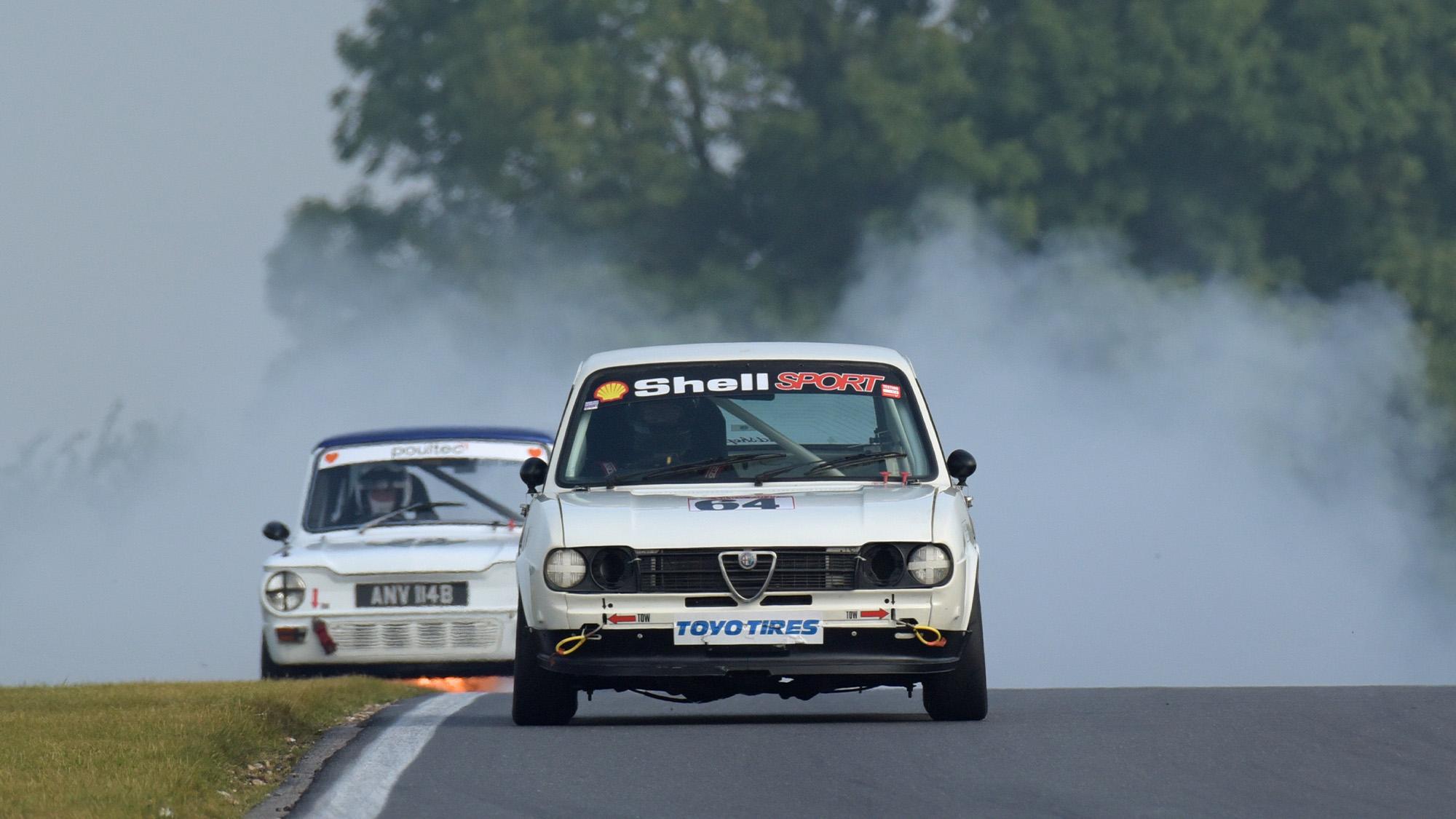 Alfasud of Keith Evans ahead of Hillman Imp on fire
