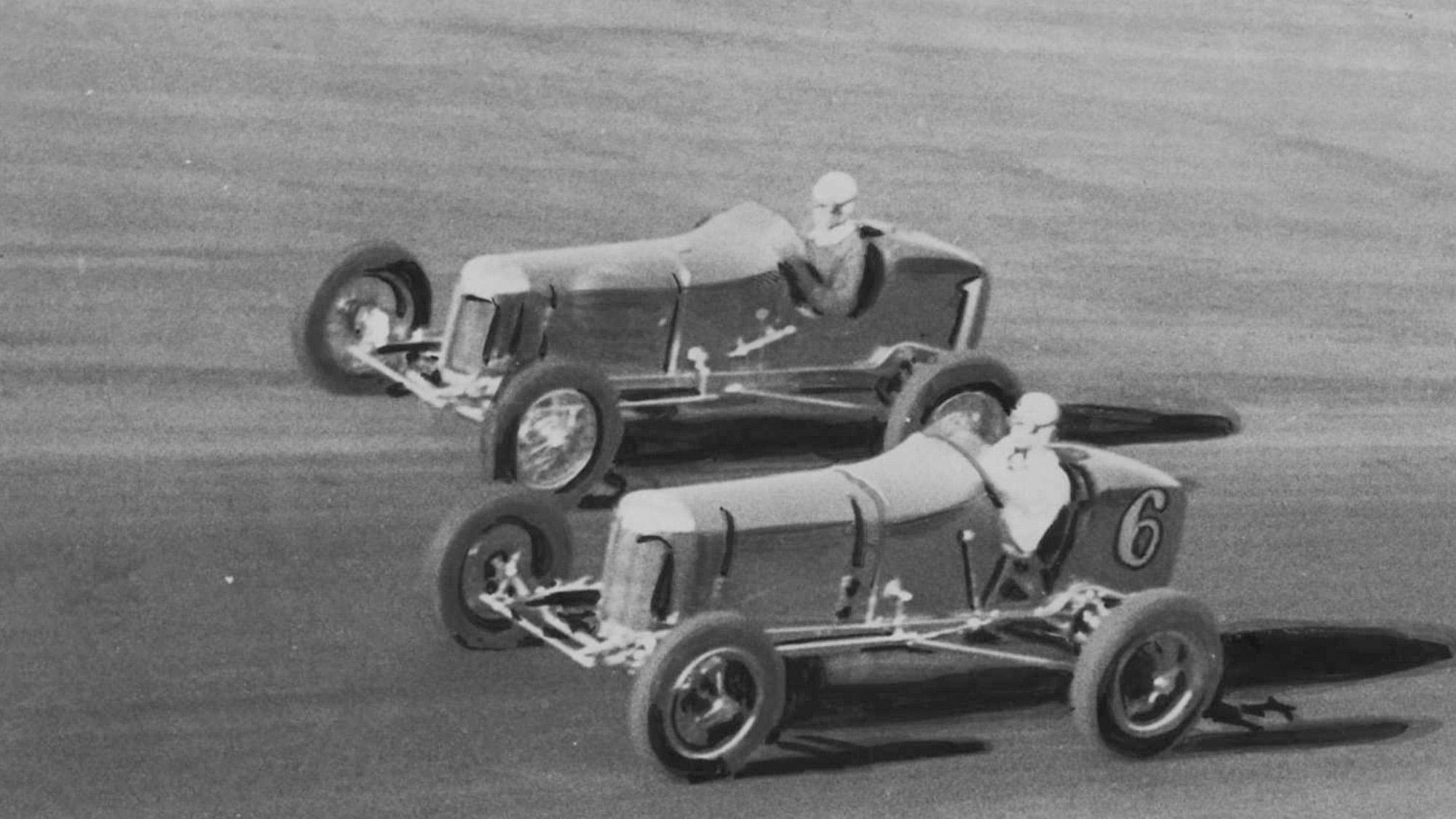 Bob Carey passes Ernie Triplett in the 1933 100-mile classic