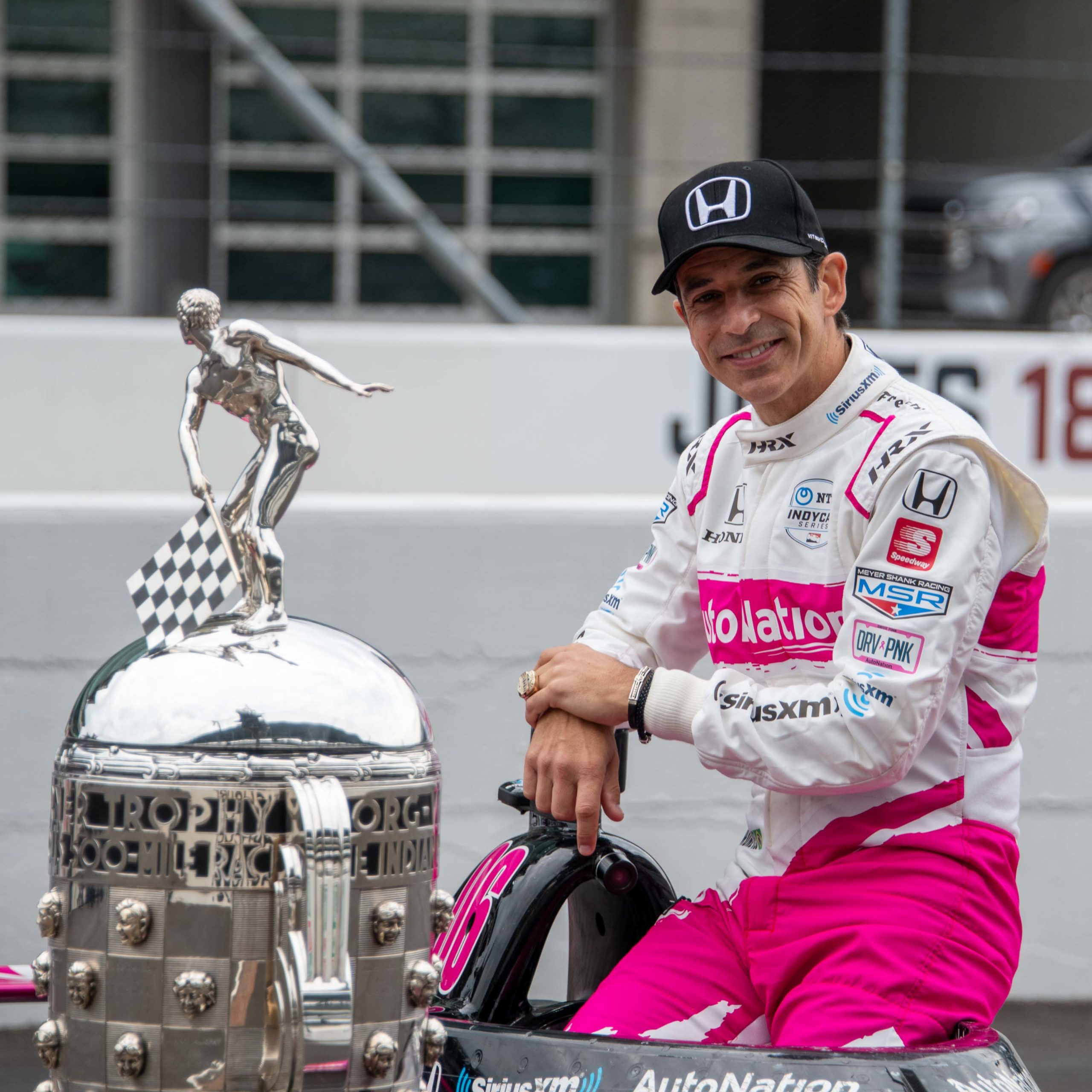 Helio Castroneves with Indy 500 trophy copy