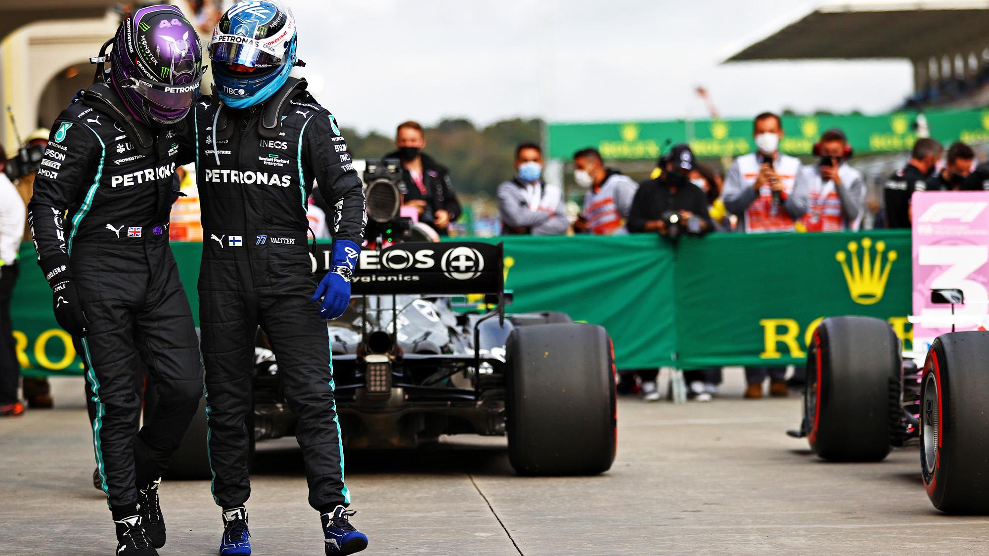 Lewis Hamilton puts his arm round Valtteri Bottas