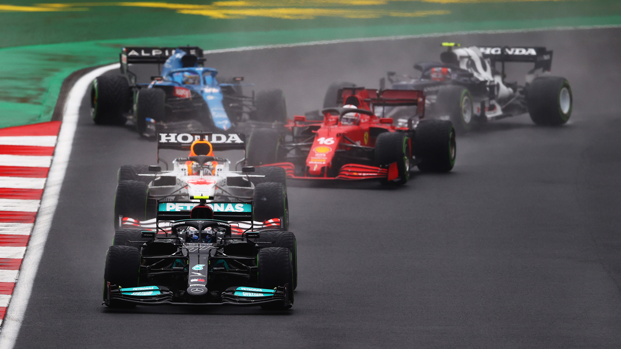 Valtteri Bottas leads and Fernando Alonso spins at the start of the 2021 Turkish Grand Prix