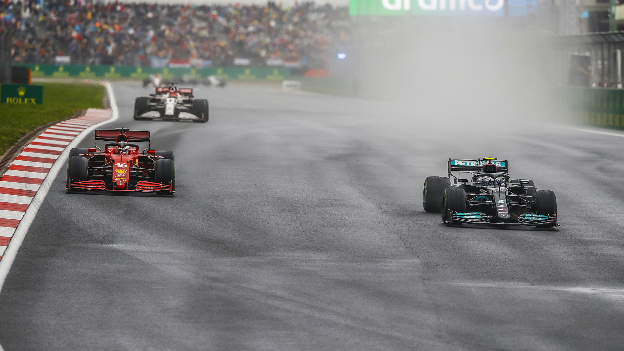 Valtteri Bottas passes Charles Leclerc for the lead of the 2021 Tuyrkish Grand Prix