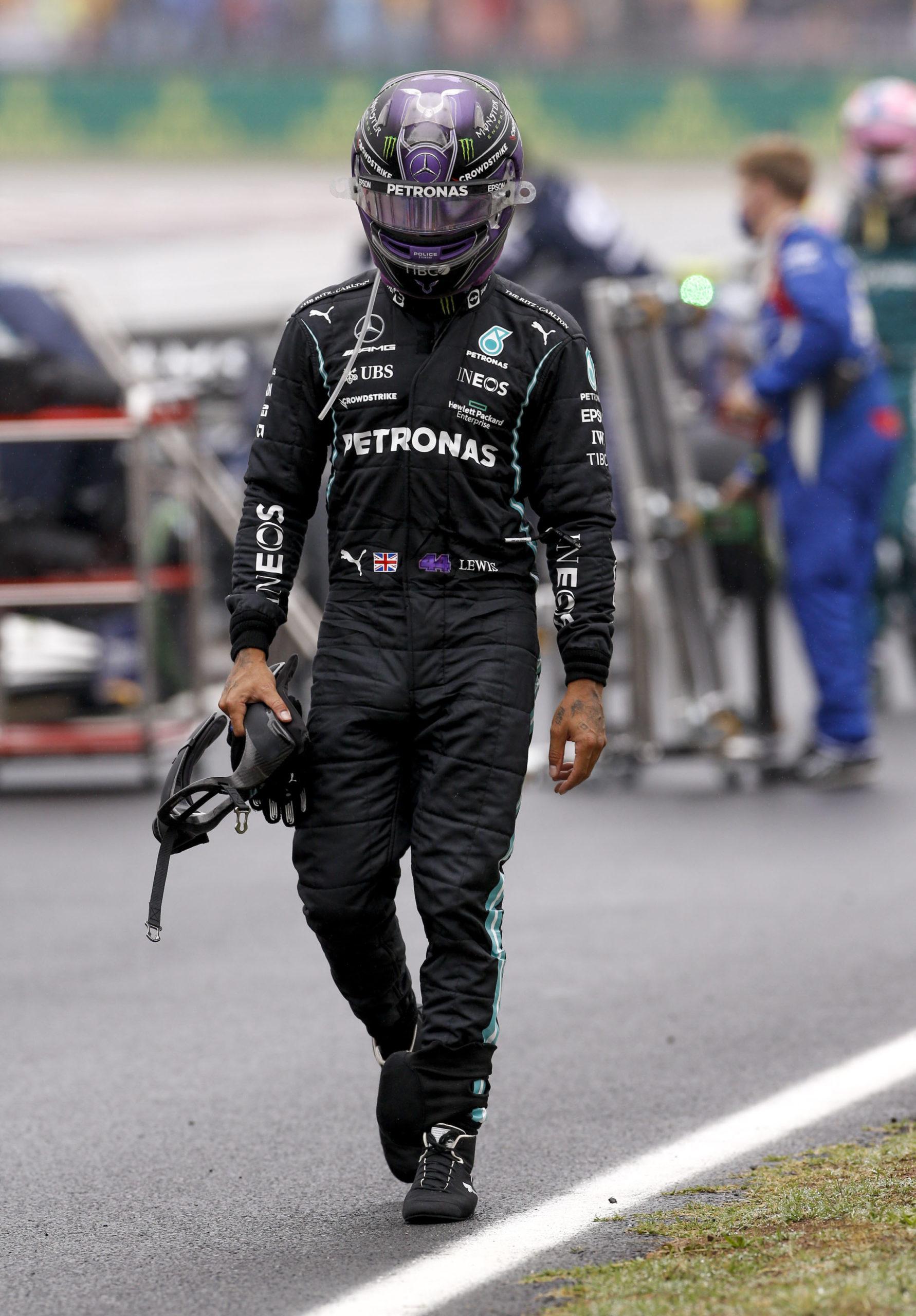 Lewis-Hamilton-walks-with-helmet-on-after-the-2021-Turkish-Grand-Prix
