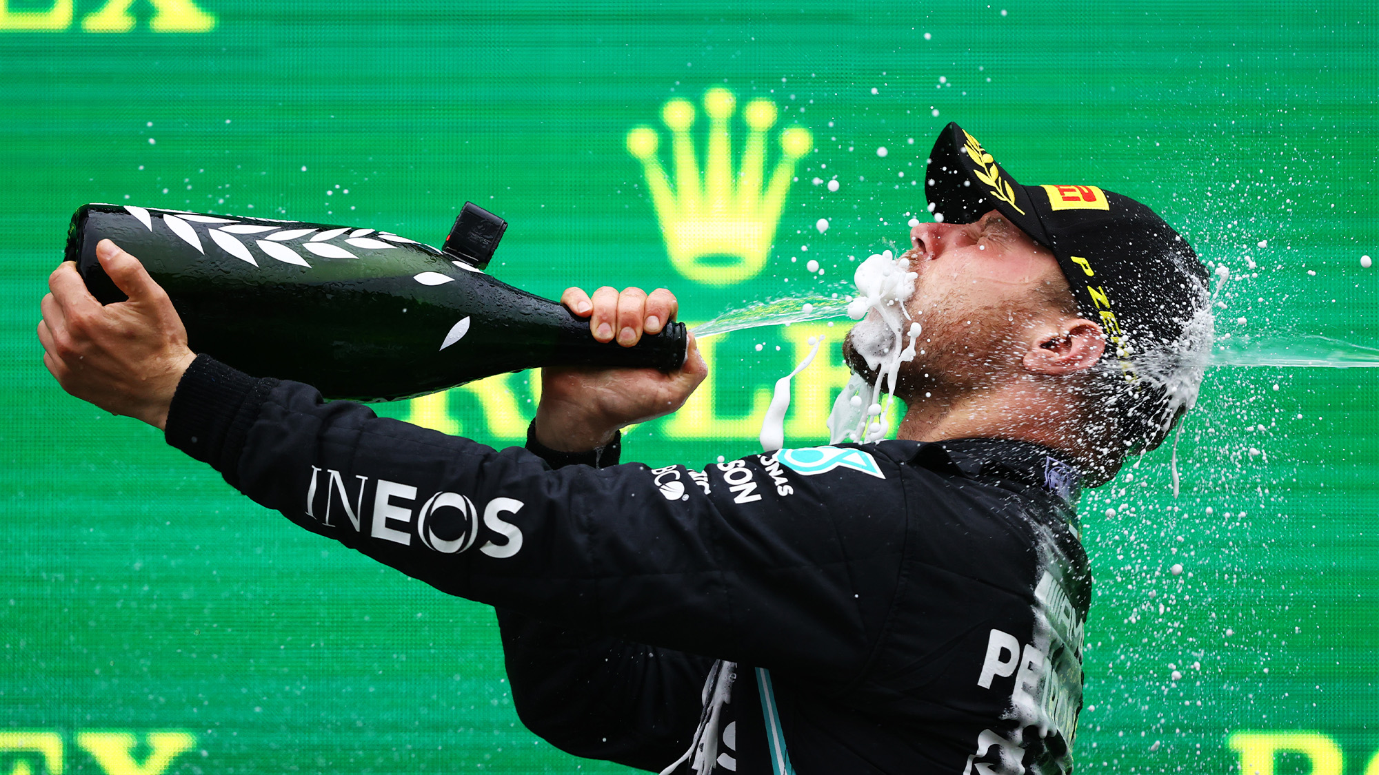 Valtteri Bottas sprays himself in the face with champagne at the 2021 Turkish Grand Prix