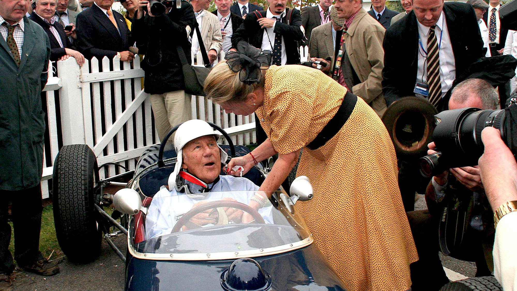 Susie Moss straps Stirling Moss in at the Goodwood revival