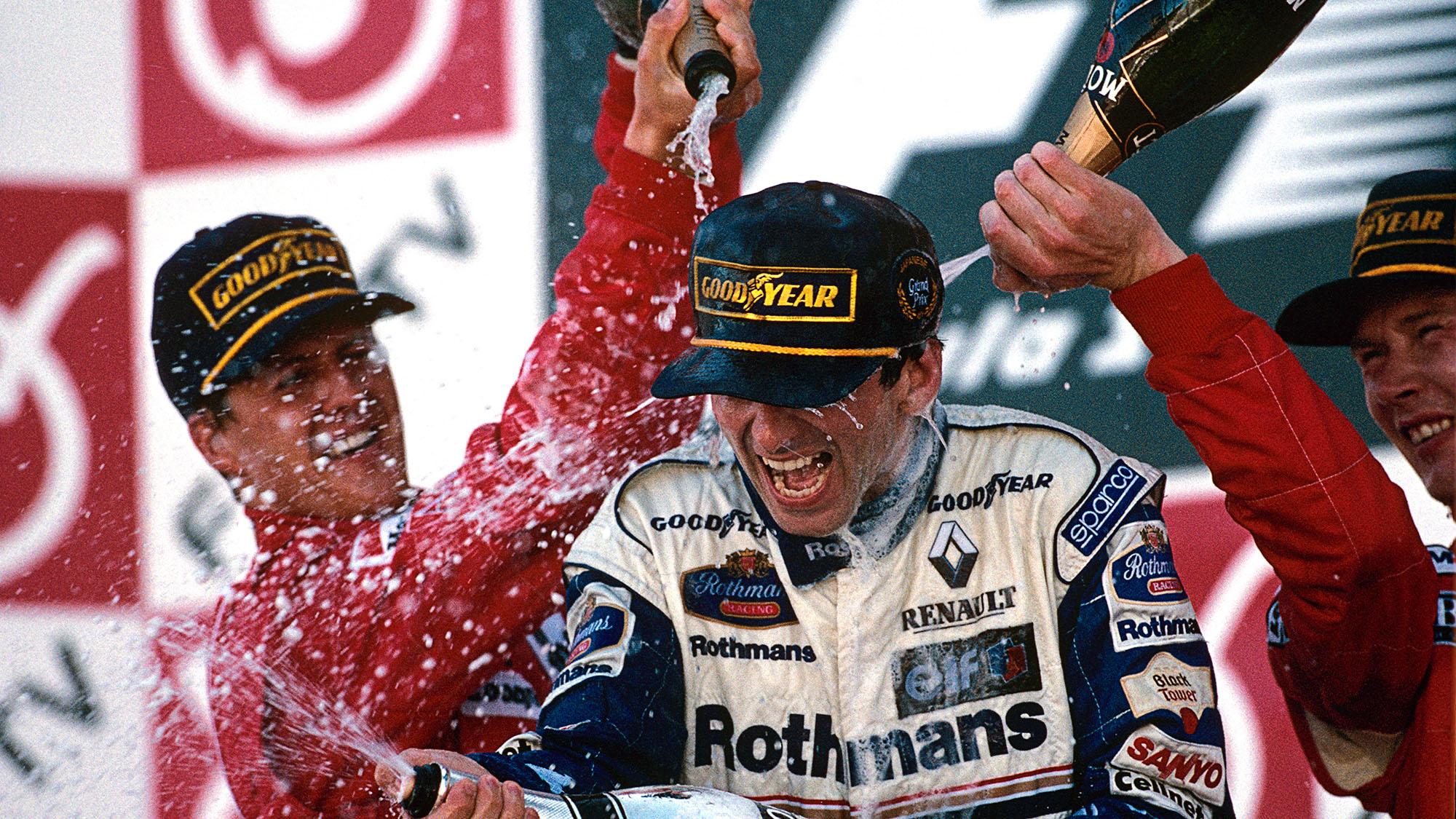 Damon Hill sprayed with champagne on the Suzuka podium in 1996