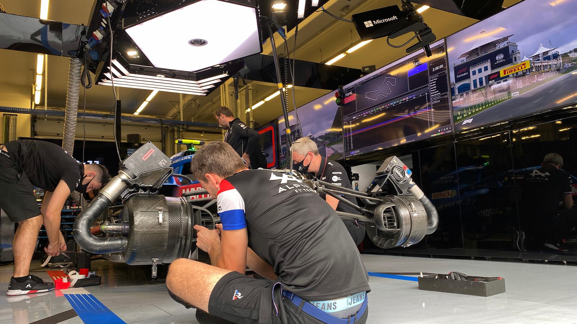 Alpine F1 mechanics at work in the garage