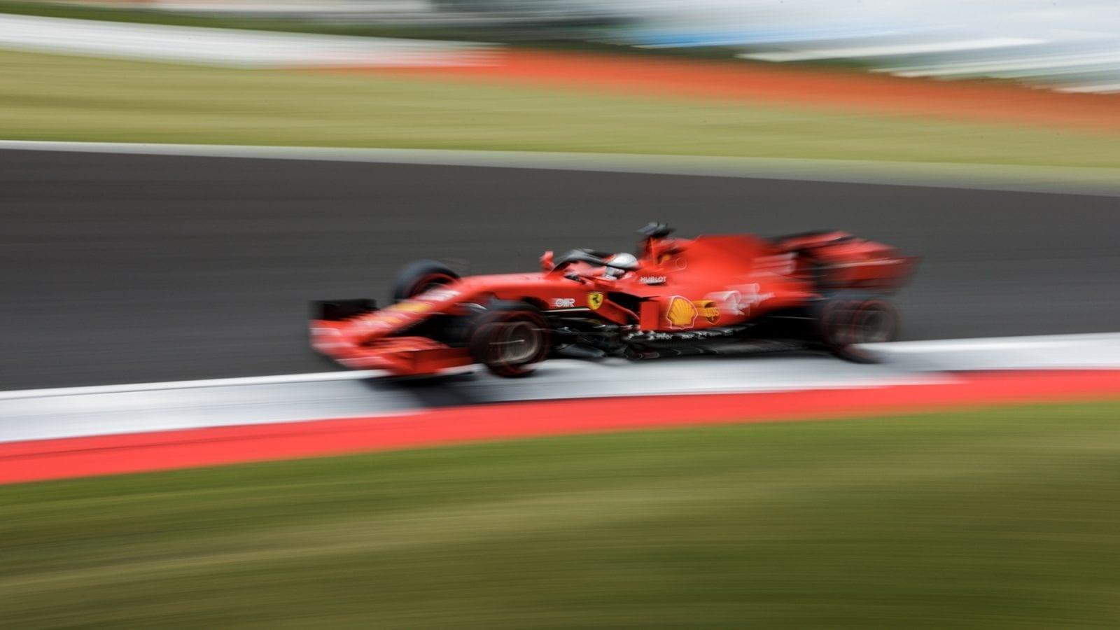 Blurred image of Sebastian Vettel's Ferrari during the 2020 British Grand Prix at Silverstone